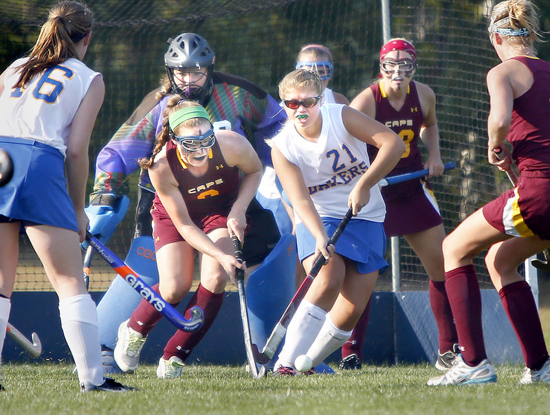 Kayla Reinhard, center, of Lake Region knocks the ball away from Lauren Steidl of Cape Elizabeth. The Lakers allowed two goals for the first time this season but still earned their sixth straight win.