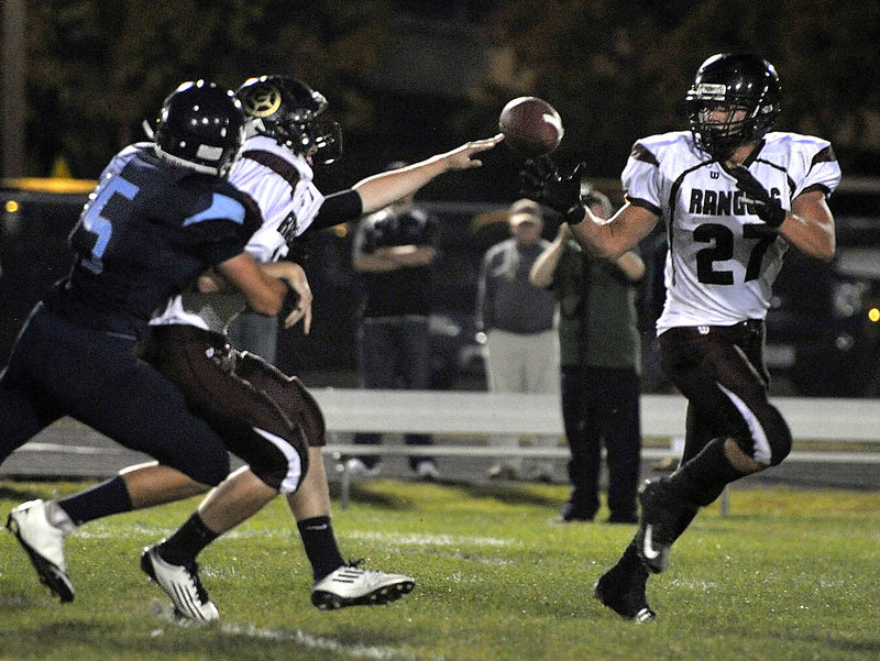 Svenn Jacobson takes a pitch Friday night as Greely looks for yardage during its 33-12 victory against Westbrook in a game between Western Class B unbeatens.