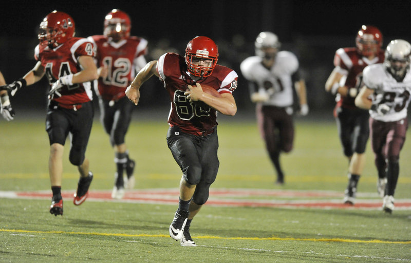 Charlie Raybine of Scarborough heads to the end zone Friday night, returning an interception 22 yards for a touchdown in the third quarter. The Red Storm improved their record to 3-0 with a 27-12 victory against Windham.