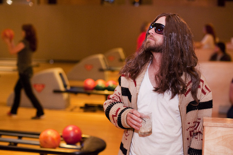 """Rob Calder of South Portland watches the action Friday at Bayside Bowl in Portland, where the third annual Viva Lebowski fundraiser was getting under way. Calder was portraying Jeff Bridges' """"The Dude"""" from the 1998 film """"The Big Lebowski."""" The bowling and movie screening party benefits United Way of Greater Portland."""