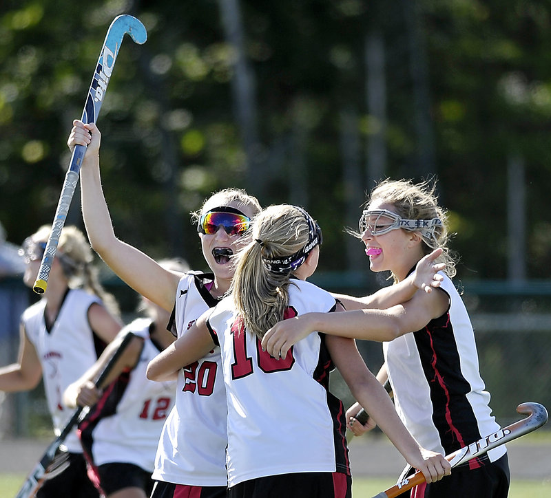 Grace Whelan, left, celebrates with Karli-An Gilbert, center, and Rose Kirsch after Whelan set up a goal by Emily Bunting that accounted for all the offense Saturday in Scarborough's 1-0 field hockey victory over Marshwood