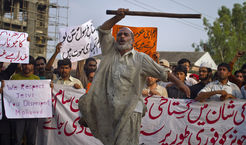 A Pakistani man shouts anti-U.S. slogans at a rally Saturday in Islamabad. For the most part, protests over an anti-Muslim film that swept 20 countries last week had eased, but not before leaving at least eight protesters dead and hundreds arrested.