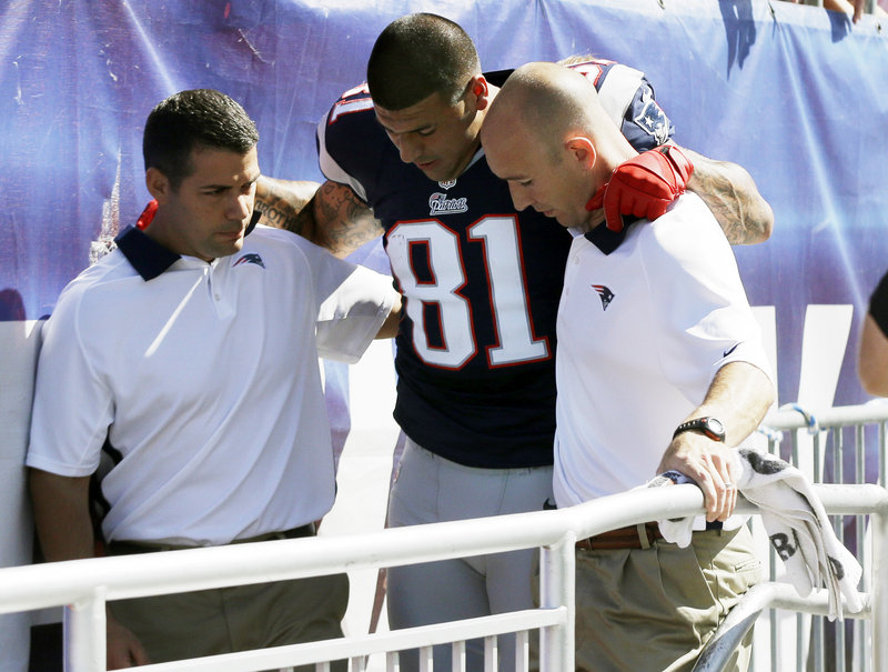 Patriots tight end Aaron Hernandez is helped to the locker room after he sustained an ankle injury in the first quarter Sunday against Arizona. He did not return.