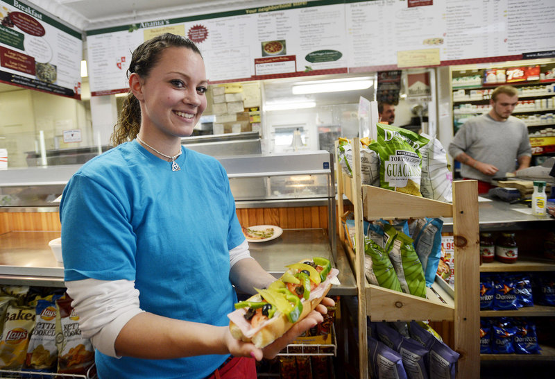 Megan Small shows off an Italian sandwich at Anania's on Broadway in South Portland. Anania's also has locations in Portland – on Washington Avenue and outer Congress Street.