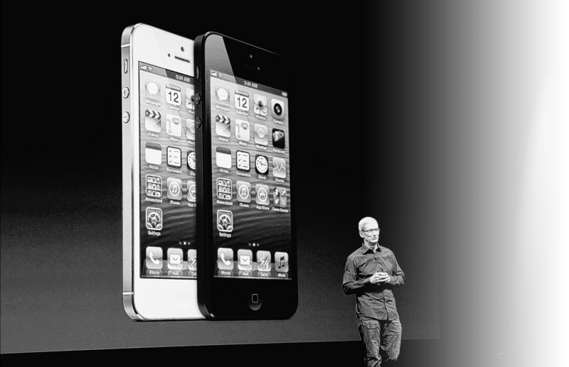 Apple CEO Tim Cook introduces the new iPhone 5 during a product unveiling at the Yerba Buena Center for the Arts in San Francisco, Calif., this month.