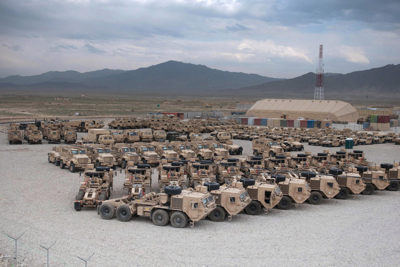 Various military vehicles sit parked after being cleaned and stripped of sensitive items for shipment as part of the drawdown of 23,000 U.S. troops by Sept. 30 at the Kandahar Air Field south of Kabul, Afghanistan. Containers are being staged at nine sites in the country.