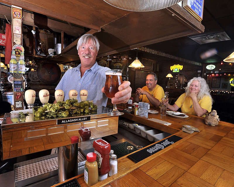Peter and Kerrilyn Welch, reps for Chickadee Wines, are regulars and enjoy lunch at the Great Lost Bear as Mike Dickson, manager and bartender, draws an Allagash Victor.