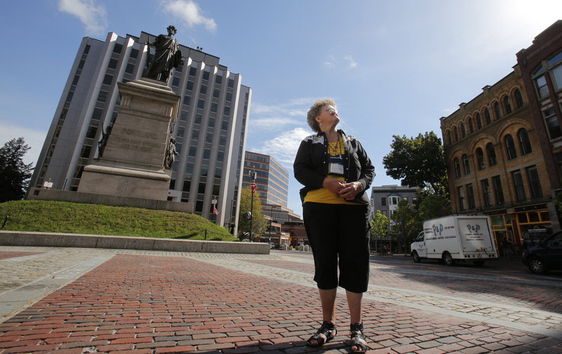 Merna Colwell of Pennsylvania takes in the site from Monument Sqaure in Portland on Tuesday, Sept. 18, 2012. She was exploring Portland with her Howard and their grandson after disembarking from the Carnival Glory cruise ship.