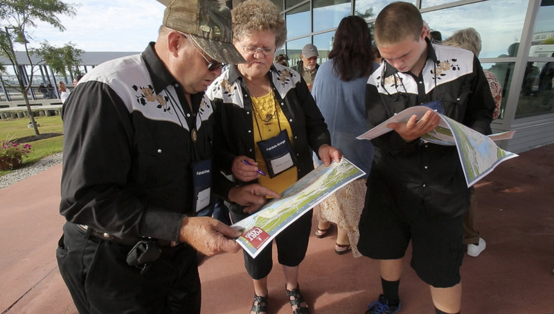 Howard and Merna Colwell and their grandson, Doug Mapes, left to right, look over maps of the city of Portland at the Ocean Gateway terminal after getting off a cruise ship on Tuesday, Sept. 18, 2012.