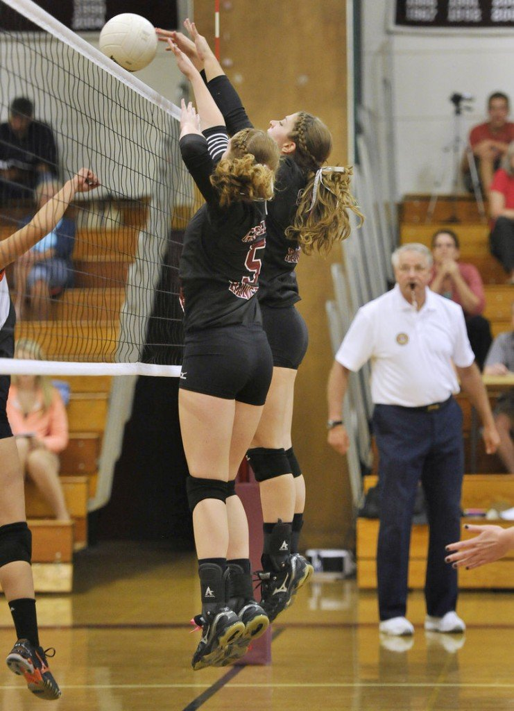 Jordynne Copp, left, and Dani Cimino of Greely take control at the net during the loss at home to Biddeford.