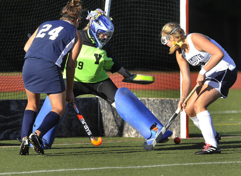 Yarmouth goalie Nicole Hickey denies Skye Dole of Fryeburg Academy as Meaghan Gorman moves in to help Wednesday. Ellen Bacchiocchi scored on the rebound. Fryeburg won, 3-0.