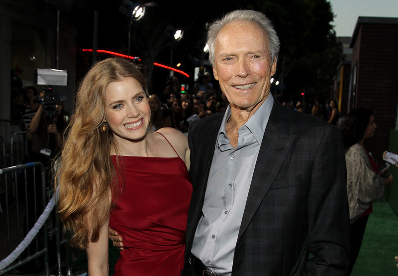 "Cast members Clint Eastwood and Amy Adams pose together at the premiere of ""Trouble With the Curve"" at the Westwood Village Theater in Los Angeles."