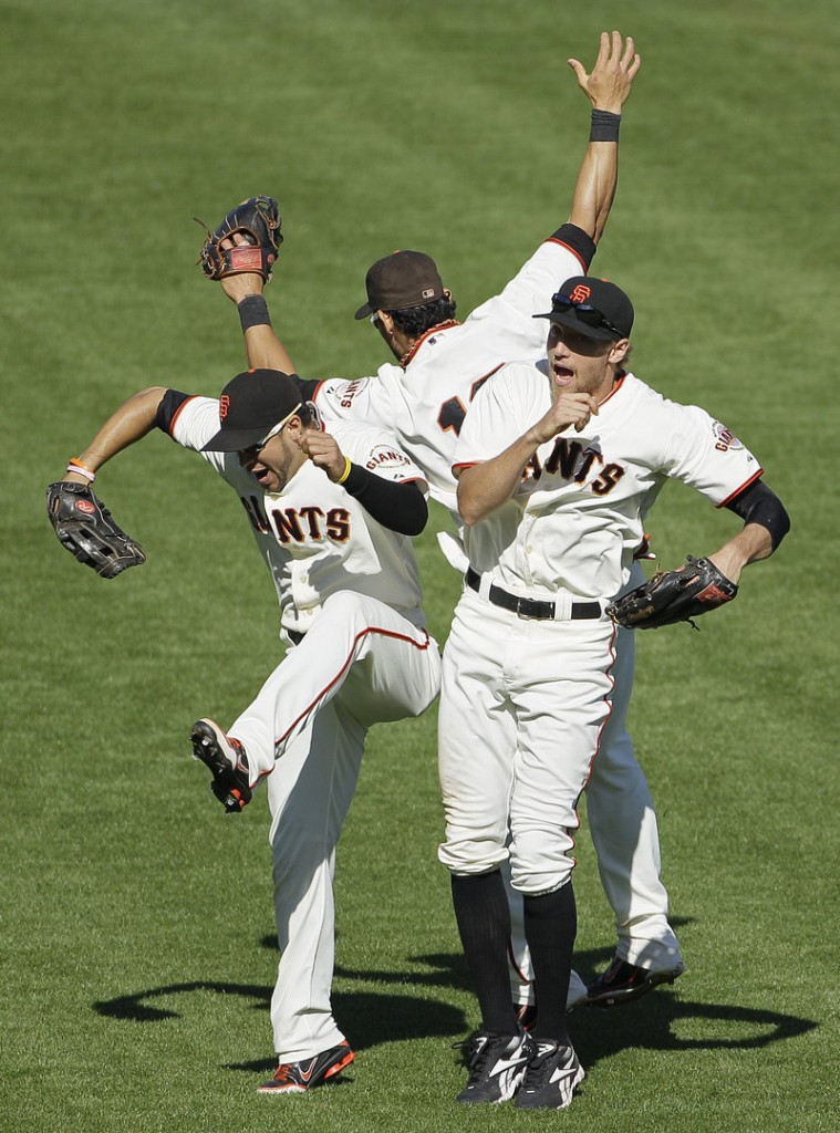 Giants outfielders Gregor Blanco, left, Angel Pagan and Hunter Pence celebrate after a 9-2 home win Thursday against the Colorado Rockies.