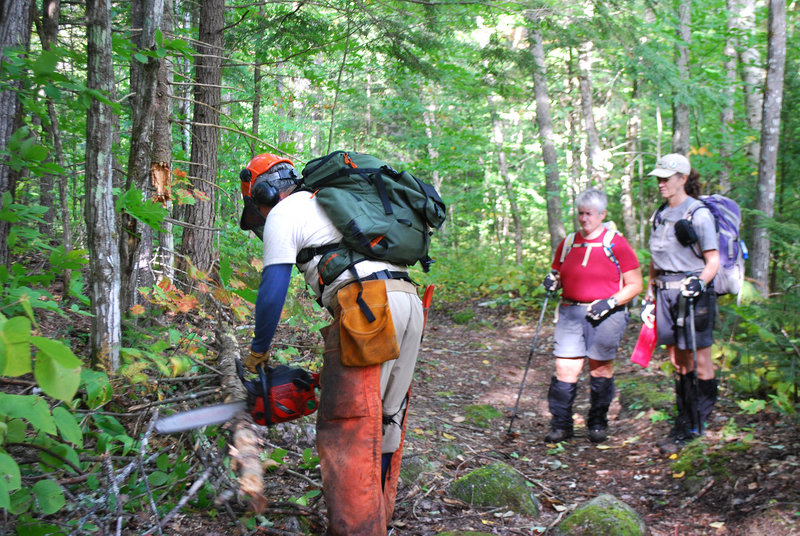 Don Miskill of Harpswell, left, volunteers on the L.L. Bean section of the Appalachian Trail with Lisa Richard, middle, and Laurie Gonyea.