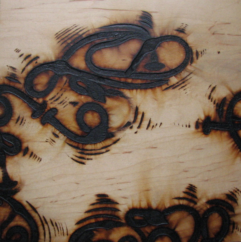 """Branded Thang,"" burned birch ply, by John Bisbee"