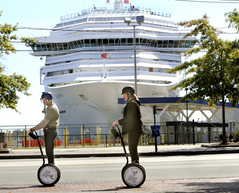 In this Sept. 25, 2012 file photo, a Segway tour passes in front of the Carnival Glory, which was tied up at the Maine State Pier. Friday was the biggest day ever for cruise ships visiting Maine, according to CruiseMaineUSA.