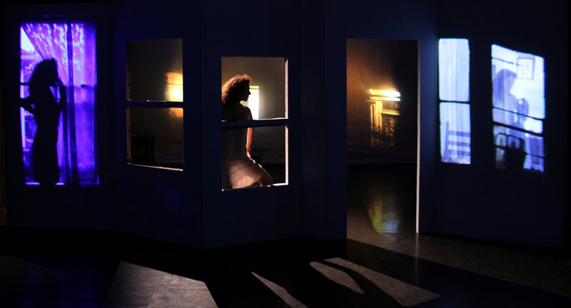 "In ""Voyeur,"" dancers will perform in front of and behind the set, with cameras projecting live images to the audience when they perform out of view of a door or window. The audience will also see projected footage shot in and around Portland."