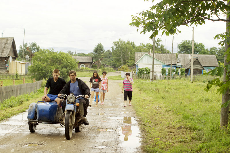 A motorcycle with a sidecar drives through Krasny Yar, a village of 680 people in the Russian Far East.