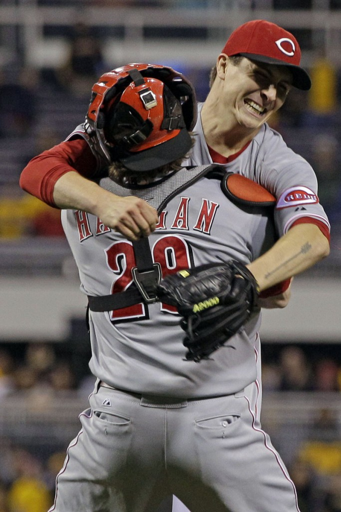 Homer Bailey of the Cincinnati Reds celebrates with his catcher, Ryan Hanigan, after Bailey threw a no-hitter against the Pittsburgh Pirates in Pittsburgh on Friday night.