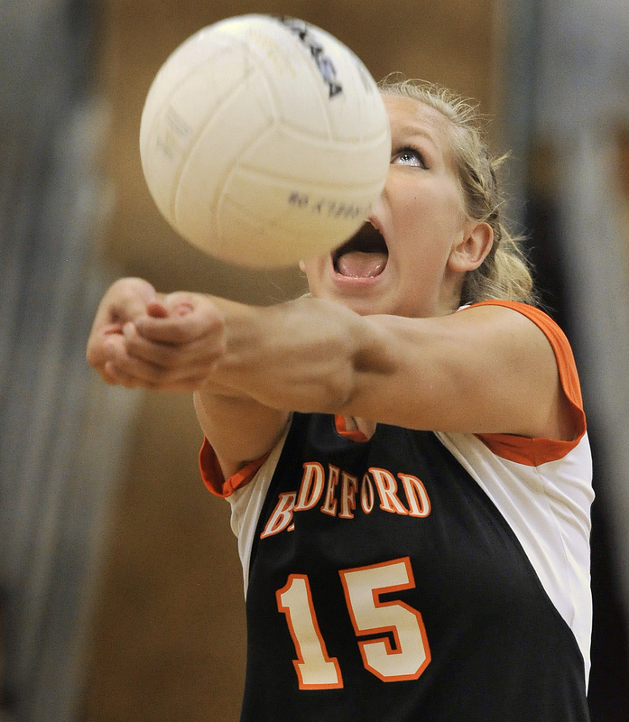 Bailey Cote of Biddeford keeps her concentration and her eyes on the ball Wednesday night while setting up a shot for a teammate during the volleyball match against Greely. Biddeford came away with a three-game victory.