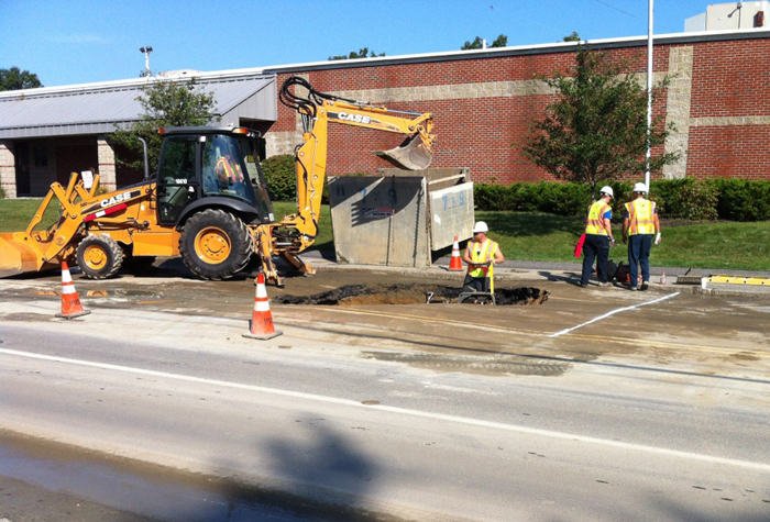 A Portland Water District Crew repairs a water main break on Broadway in South Portland on Friday.