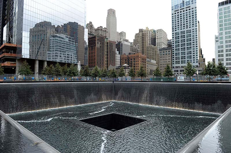 The World Trade Center North Tower memorial pool at the National September 11 Memorial and Museum is seen against the New York City skyline. The foundation that runs the memorial estimates that once the roughly $700 million project is complete, it will cost $60 million a year to operate.