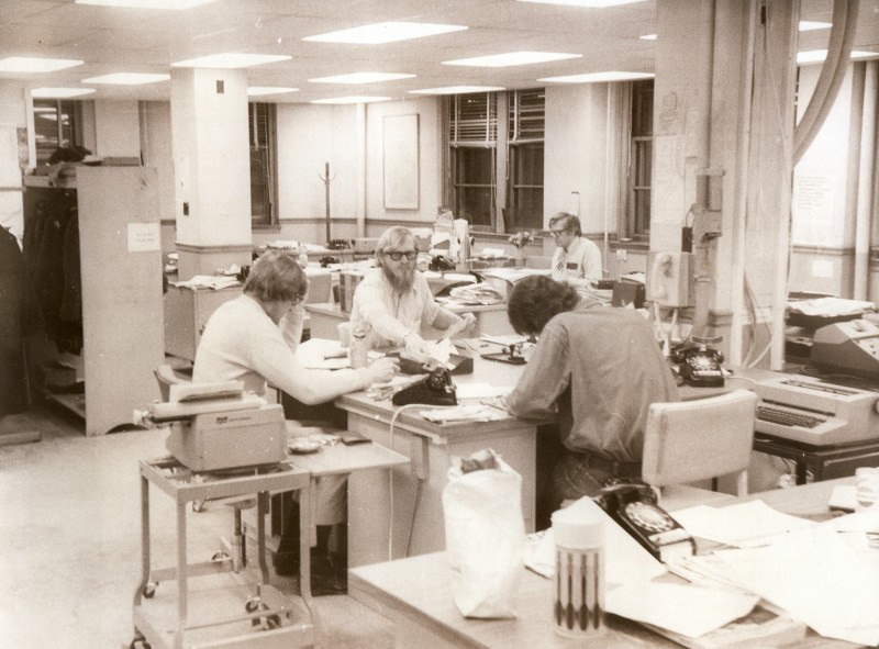 The Press Herald newsroom in the mid 1970s. From left are George Weir, D.C. Dreger, Ed Rice, and, Bob Bob Cummings. Typewriters and telephones are still in evidence. It wasn't until 1978 that the typewriters were replaced by a computerized electronic editing and production system.