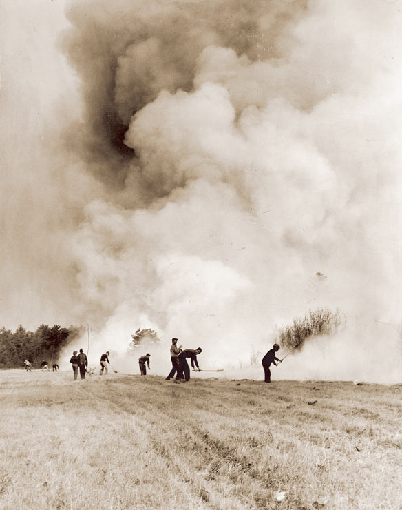 A line of volunteers tries to hold back the flames in a field in Biddeford Pool. In all, more than 250,000 acres burned across the state in the 1947 inferno.
