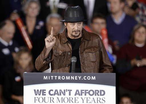 FILE - This Oct. 8, 2012 file photo shows recording artist Kid Rock speaking before introducing Republican vice presidential candidate, Rep. Paul Ryan, R-Wis., at a rally at Oakland University in Rochester, Mich. Dozens of celebrities, elected officials, and others are blitzing through battleground states in the White House race�s final days. Their goal: give the presidential campaigns a daily presence in key states even when the men at the top of the ticket (and their running mates) pitch for votes elsewhere. (AP Photo/Paul Sancya, File)