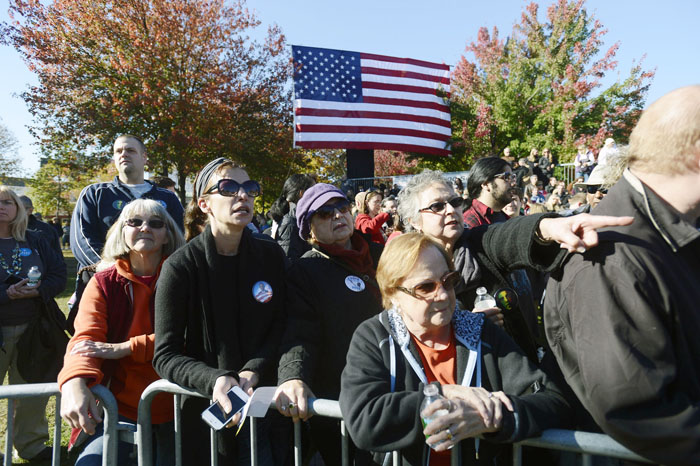 A crowd gathers and waits to hear President Barack Obama speak at Veterans Memorial Park in Manchester, N.H., on Thursday.
