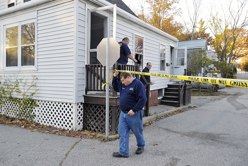 Sgt. Joel Davis and other investigators from the State Fire Marshal's Office leave the home of Patricia Noel, 62, of 44 Wesley Ave., on Tuesday, October 23, 2012.