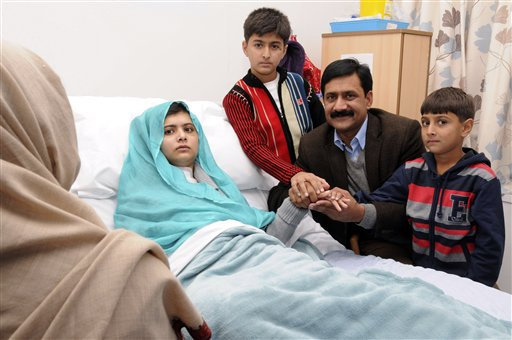 In photo issued by Queen Elizabeth Hospital, in Birmingham, England, on Friday, Malala Yousufzai poses with her father Ziauddin, and her two younger brothers, Atal, right, and Khushal.