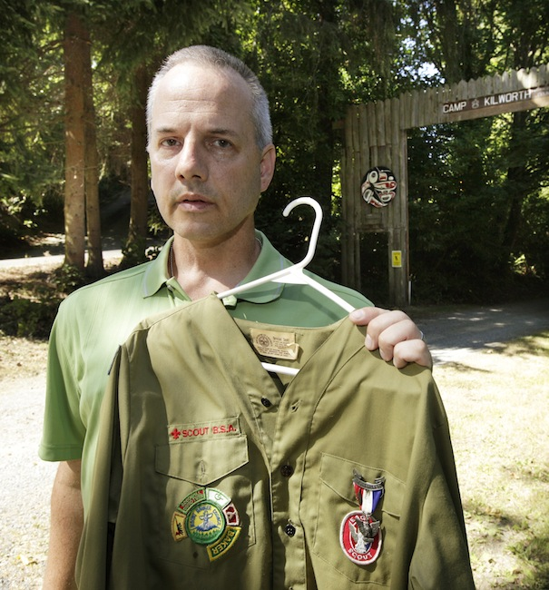 """In this Thursday, Aug. 16, 2012 file photo, Boy Scout abuse victim Tom Stewart poses for a photo with his old Scout uniform outside the Boy Scout Camp Kilworth in Federal Way, Wash. """"There are so many victims who have suffered in silence. Marriages and relationships with their kids have suffered,"""" said Stewart, a 46-year-old engineer for Boeing. (AP Photo/Ted S. Warren)"""
