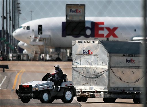 FedEx workers unload planes at the Memphis International hub earlier this month. FedEx expects to handle 280 million shipments between Thanksgiving and Christmas, up 13 percent from last year.
