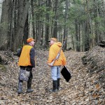 """Staff photo by Andy Molloy DEER ARE: Bill Moulton, right, of Pittston, chats with his pal, Gary Alexander, of Gardiner, as they walk down a path in a wood in South Gardiner in pursuit of Whitetail deer. Moulton said the men have been hunting together """"for about 68 years."""""""