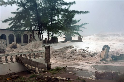 Waves, brought by Hurricane Sandy, crash on a house in the Caribbean Terrace neighborhood in eastern Kingston, Jamaica, Wednesday, Oct. 24, 2012. Hurricane Sandy pounded Jamaica with heavy rain as it headed for landfall near the country's most populous city on a track that would carry it across the Caribbean island to Cuba, and a possible threat to Florida. (AP Photo/Collin Reid)