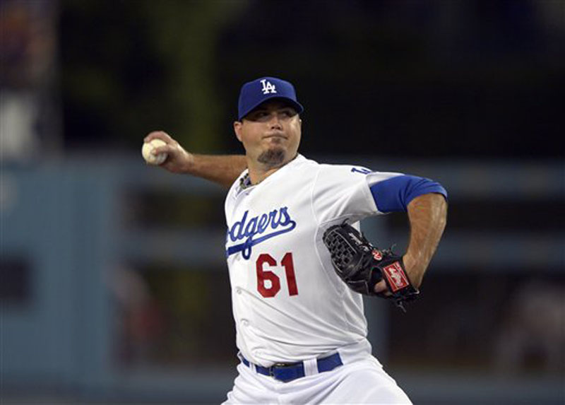 Los Angeles Dodgers starting pitcher Josh Beckett throws to the plate during the first inning of their baseball game against the St. Louis Cardinals, Thursday, Sept. 13, 2012, in Los Angeles. (AP Photo/Mark J. Terrill)