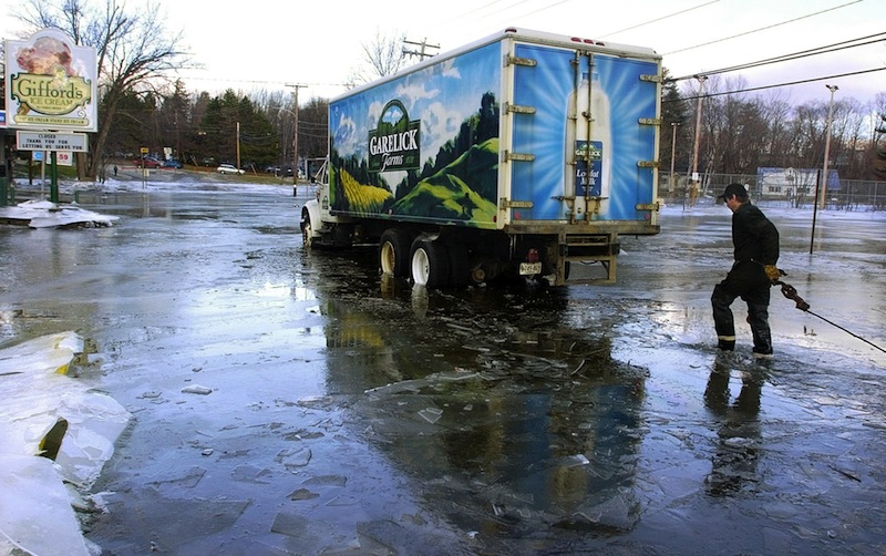 In this 2006 file photo, a Garelick Farms truck sits near U.S. Route 2 in Farmington. Garelick Farms is ending production at its Bangor milk-processing plant and laying off 35 employees.