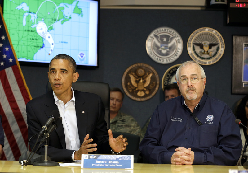 President Obama attends a briefing with Federal Emergency Management Agency administrator Craig Fugate, right, at the National Response Coordination Center at FEMA headquarters in Washington on Sunday.