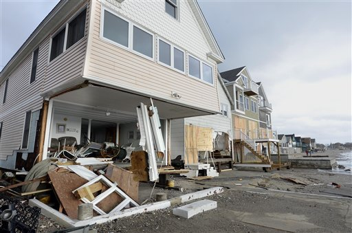Wreckage lies outside damaged beachfront homes in the aftermath of superstorm Sandy in Milford, Conn., on Tuesday.