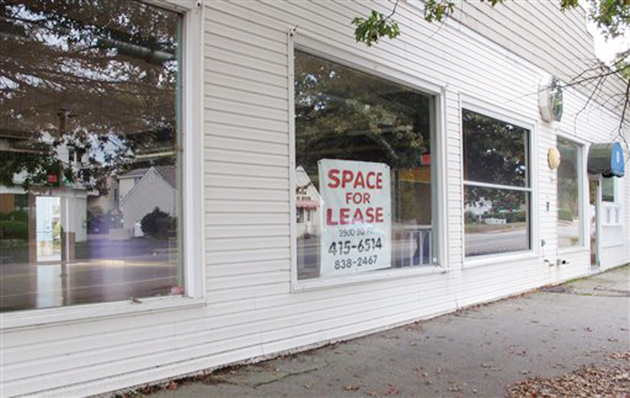 A for lease sign hangs in the window of the former Pura Vida fitness studio in Kennebunk recently. Alexis Wright has been charged with running a prostitution operation out of the studio and a nearby one-room office.