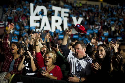 Supporters cheer for former President Bill Clinton before Vice President Joe Biden spoke at a campaign rally at the Covelli Centre, Monday, Oct. 29, 2012, in Youngstown, Ohio. (AP Photo/Matt Rourke)