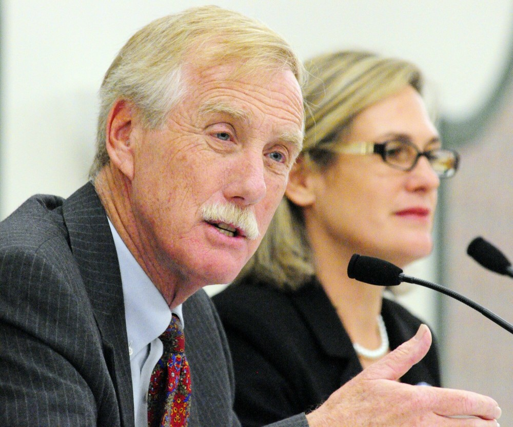 Staff photo by Joe Phelan United States Senate candidates Angus King, left, and Cynthia Dill participate in the Maine Municipal Association's debate on Thursday afternoon at the Augusta Civic Center.