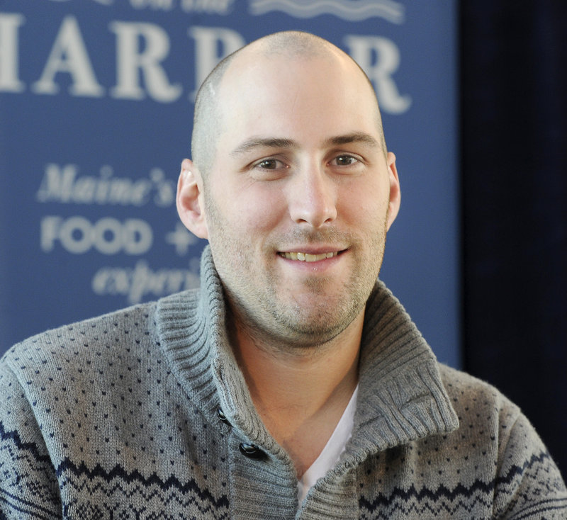 Kevin Walsh of Earth at Hidden Farm in Kennebunk is among the Top of the Crop competition finalists. The others are Shannon Bard of Zapoteca in Portland, Eric Flynn of Freeport's Harraseeket Inn and Jeff Landry of The Farmer's Table in Portland. Walsh is seen at last week's Harvest on the Harbor preview at Ocean Gateway in Portland.