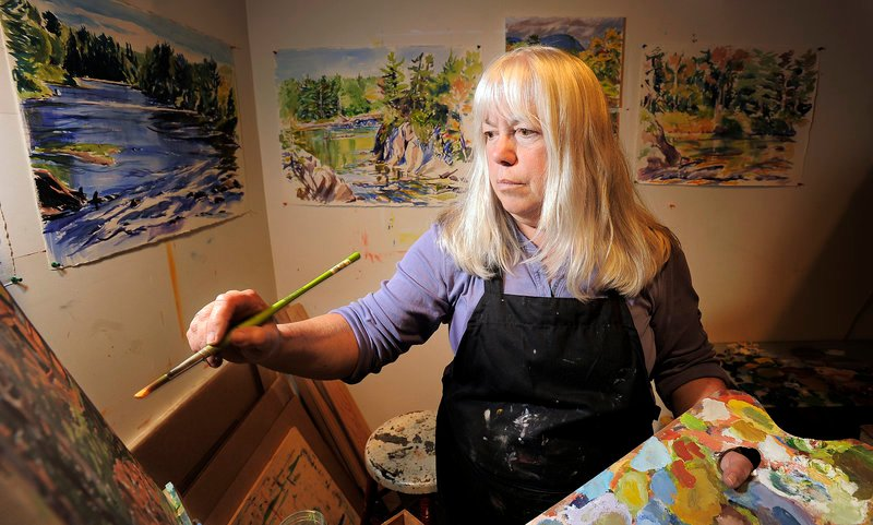 Painter Marsha Donahue operates North Light Gallery in downtown Millinocket. She plans to vote for President Obama, partly to qualify for insurance under Obama's health care law.
