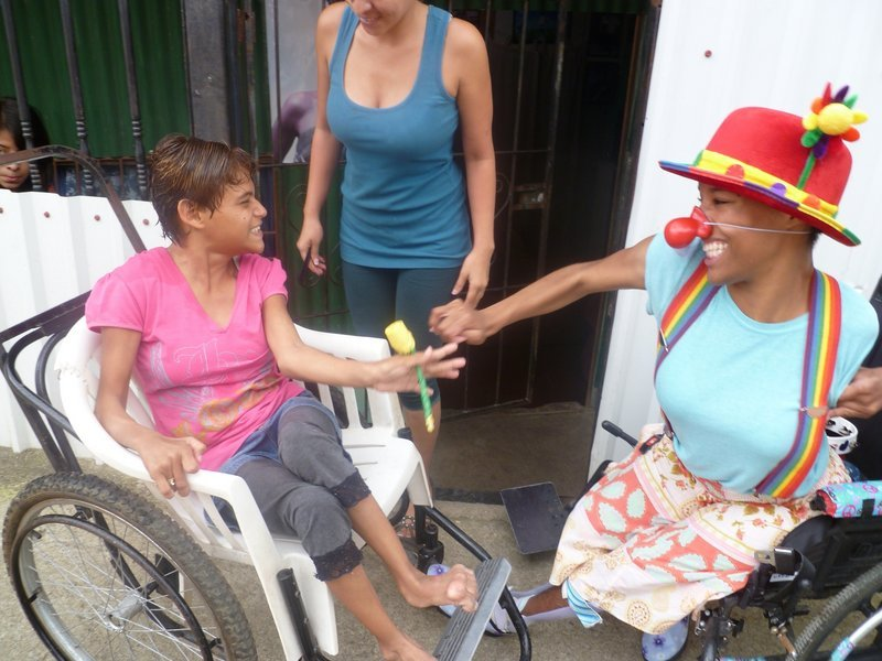 Elizabeth Meade has fun clowning in Costa Rica with Ingrid, left, who has cerebral palsy.