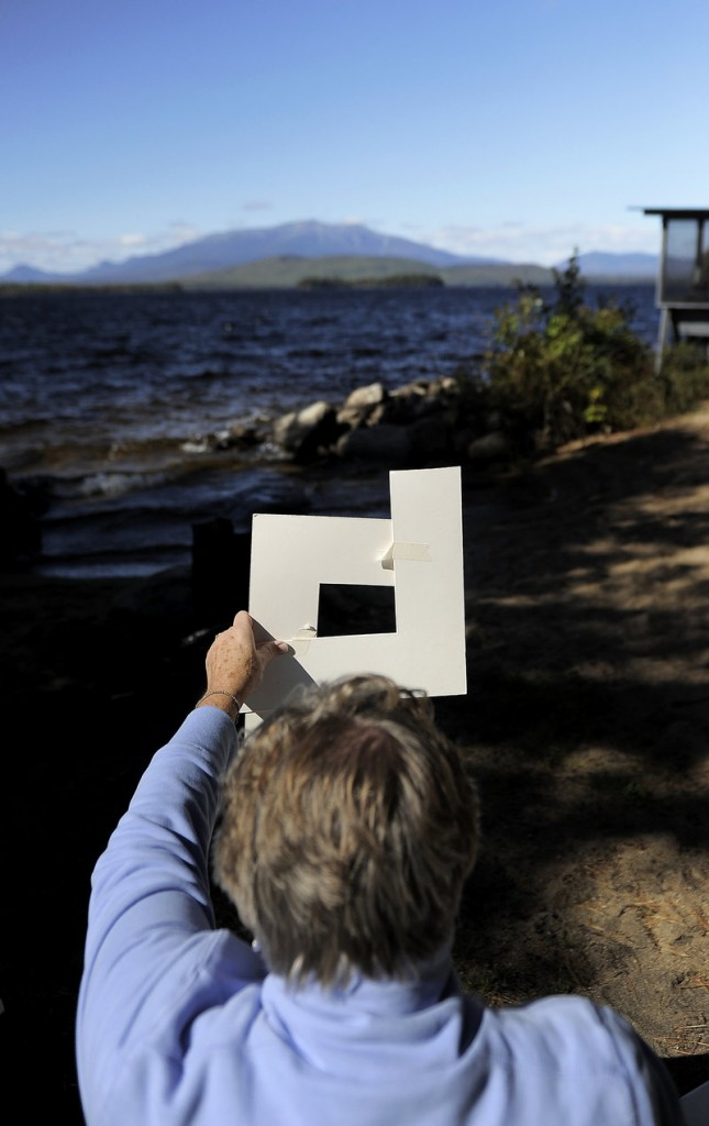 Sandra Pye of Phippsburg frames Katahdin before beginning to paint.