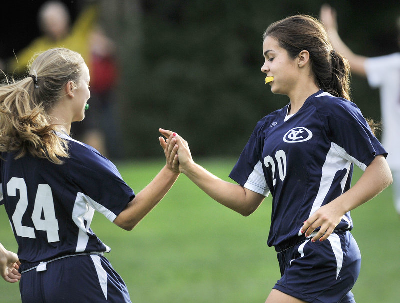 Eavan O'Neill of Yarmouth, right, is congratulated by Emma Torres after scoring the tying goal in the second half Tuesday in a 1-1 tie against Freeport.