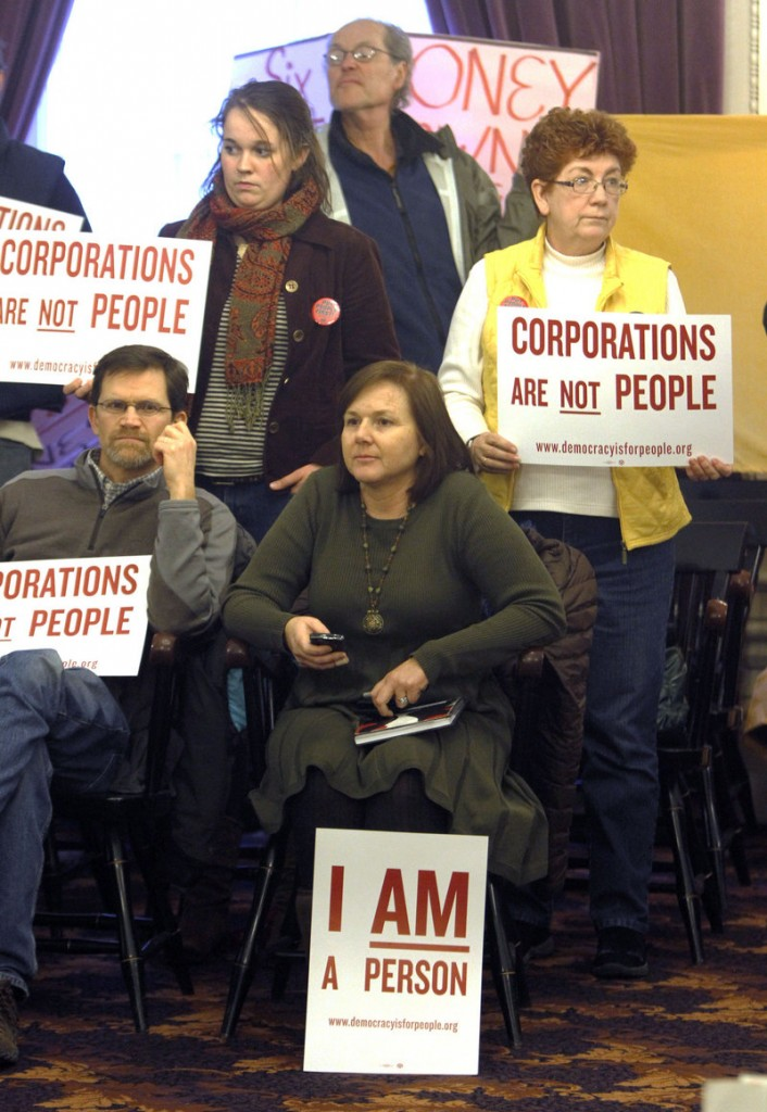 On the anniversary of the Citizens United ruling in January, people at a Burlington, Vt., rally hold signs calling for a constitutional amendment overturning the ruling.