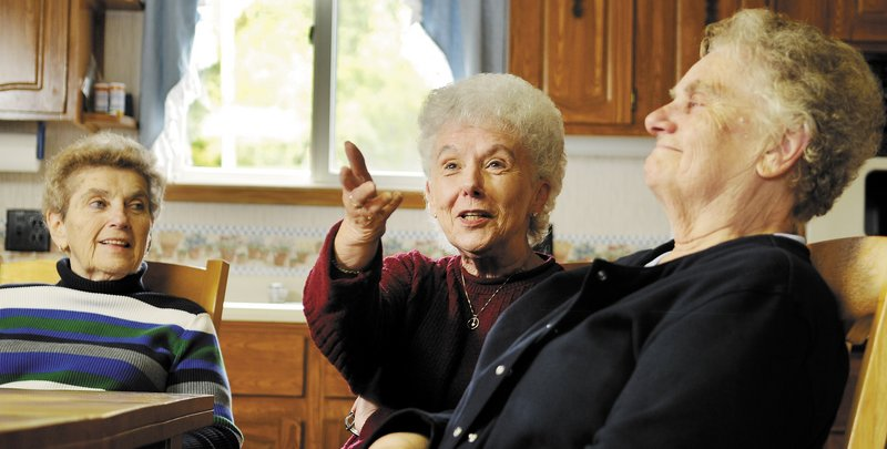 Sisters Christine Dupuis, right, Lorraine Danforth and Edna Doyon recalled growing up in Augusta in the 1950s.